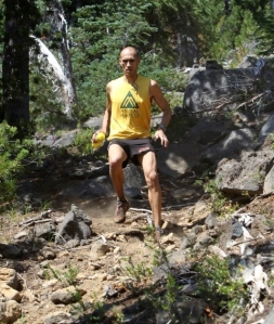 Yassine-diboun-running-downhill-Waldo-100k-ultra-marathon